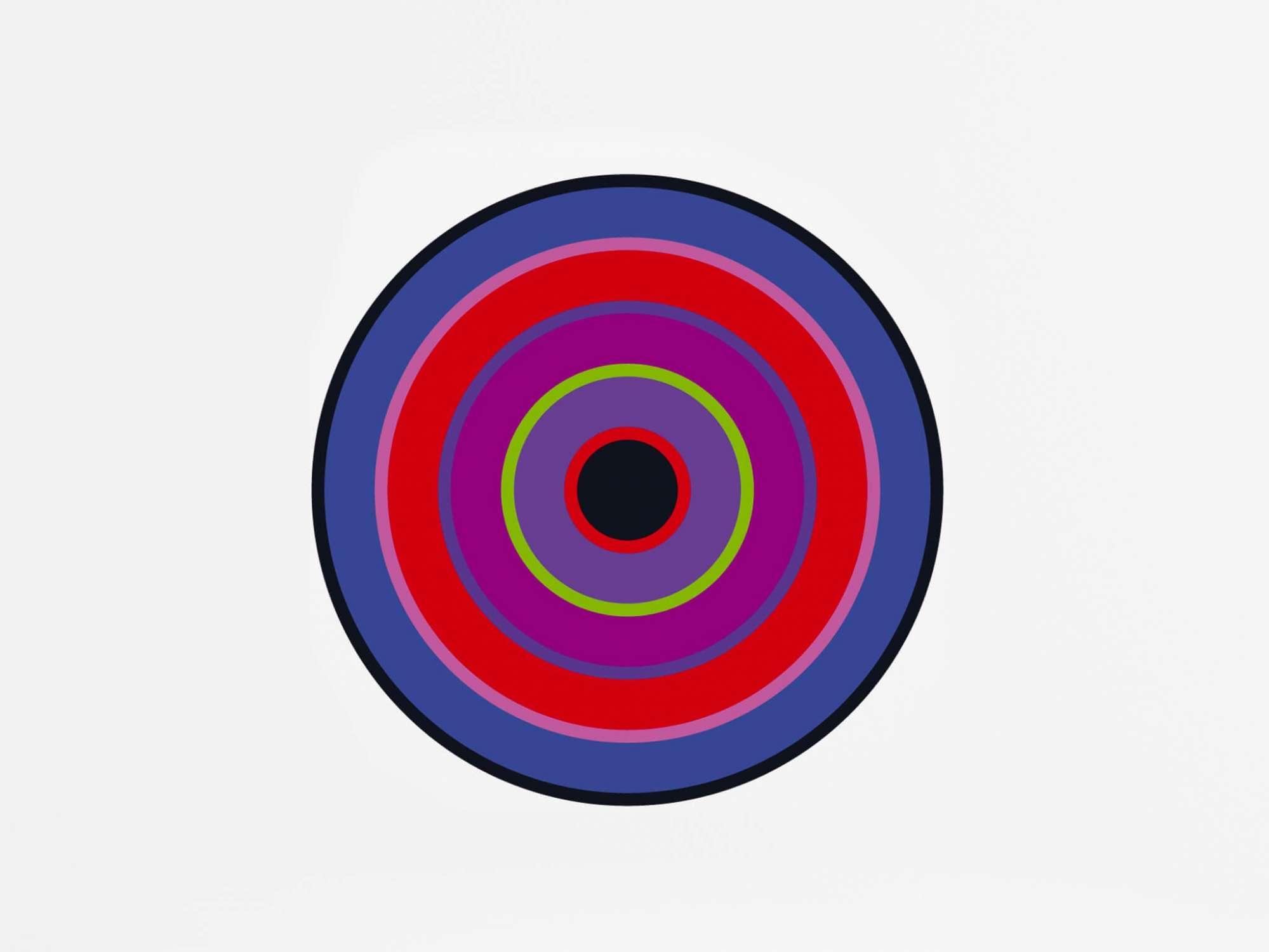 un sticker mural design en forme de cible pour donner une touche de couleur a un intérieur minimaliste.