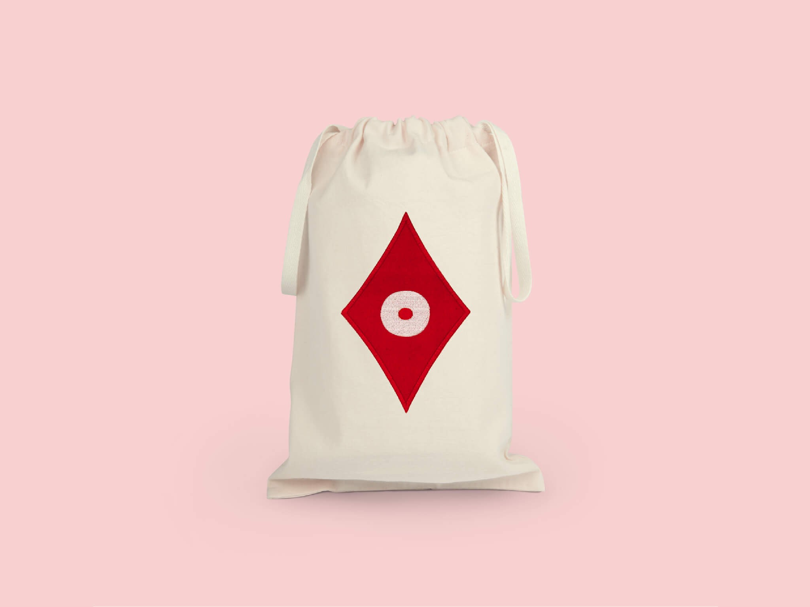 la pochette  de voyage carreau, elle reprend le motif carreau pokerface phares du studio Ich&Kar.