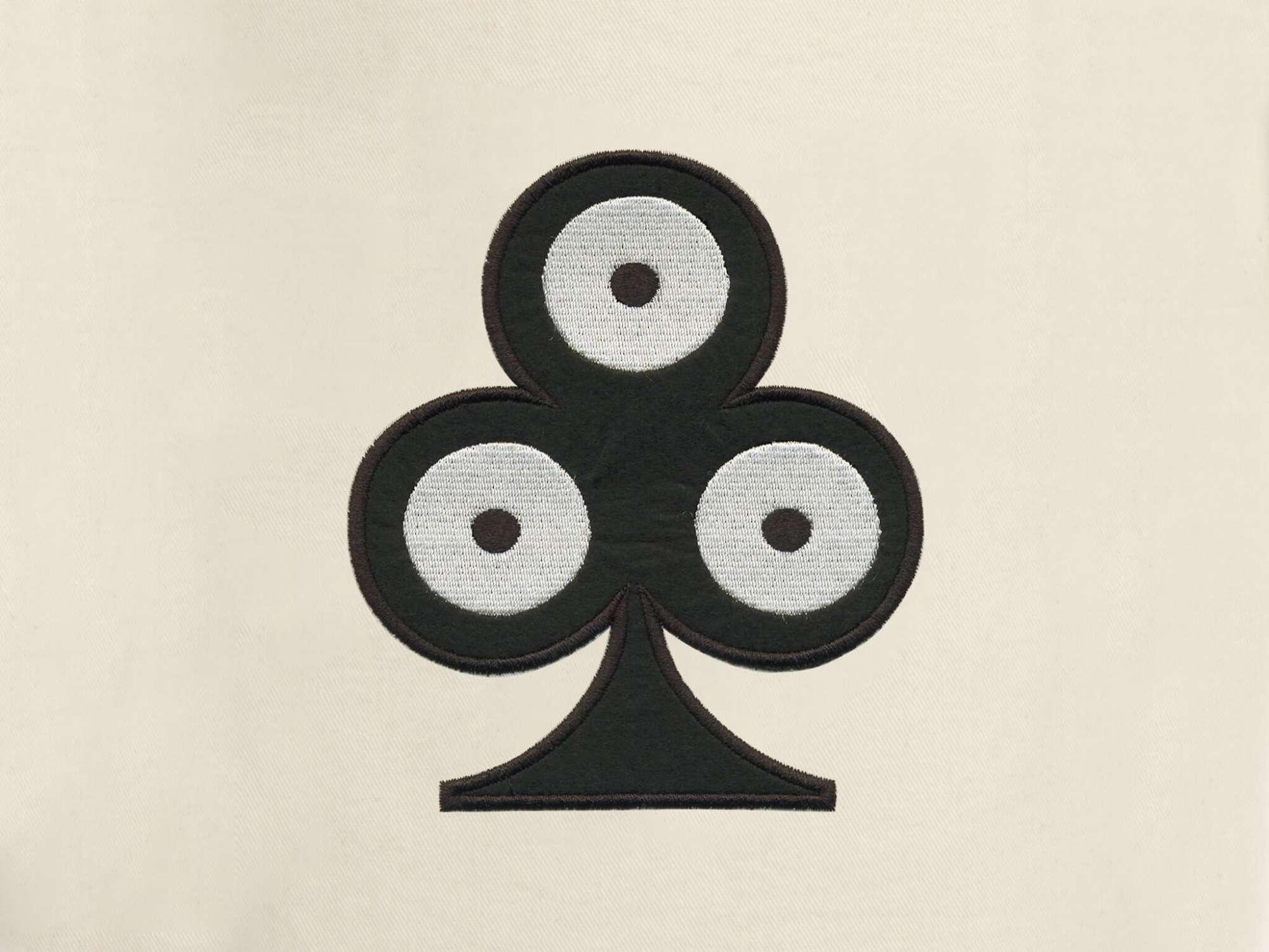détail de la pochette de voyage trèfle, elle reprend le motif trèfle pokerface phares du studio Ich&Kar.